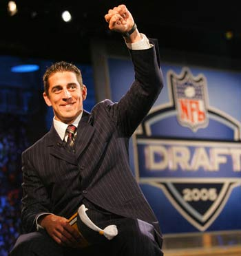 http://purplejesus.files.wordpress.com/2011/04/aaron-rodgers-draft-day.jpg