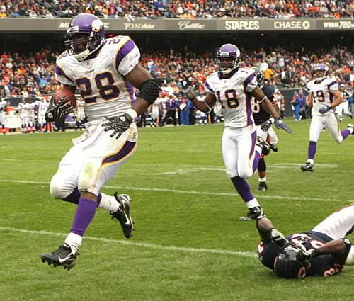 http://purplejesus.files.wordpress.com/2011/10/adrian-peterson-vikings-bears-2007.jpg