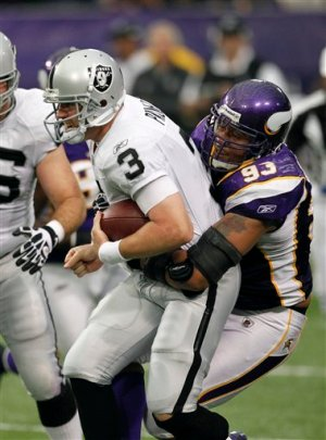 http://purplejesus.files.wordpress.com/2011/11/kevin-williams-sack-raiders.jpg?w=300